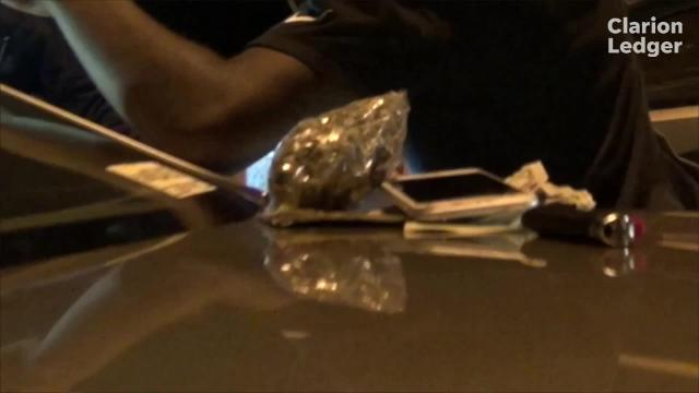 A driver was pulled over with a decent-sized bag of weed and tried to hide it from police.