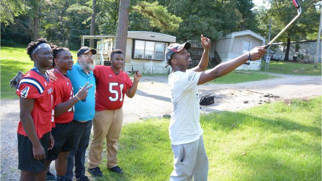 Four Jackson football players helped with a man's free lawn service Friday. Rodney Smith Jr. is in the second round of his 50 States 50 Lawns journey.