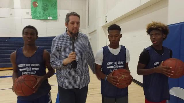 Shad Powers walks and talk with three guards on the Desert Hot Springs basketball team