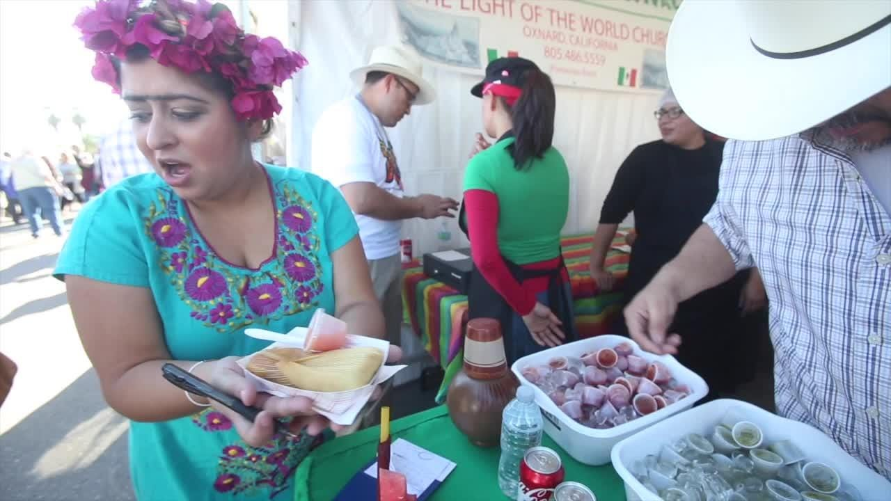 Thousands milled through downtown Indio for the 25th annual International Tamale Festival kick-off. (Dec. 3, 2016)