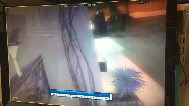 On Saturday, Jan. 20, 2018, a person in a black robe and white mask walked up to the entrance of Wang's in the Desert in Palm Springs and appeared to spray paint a message on the door.
