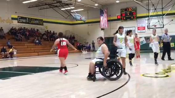 Coachella Valley High School girls' basketball player Clara Garcia, confined to a wheelchair due to spina bifida, scored two points in the team's season finale against Desert Mirage on Friday.