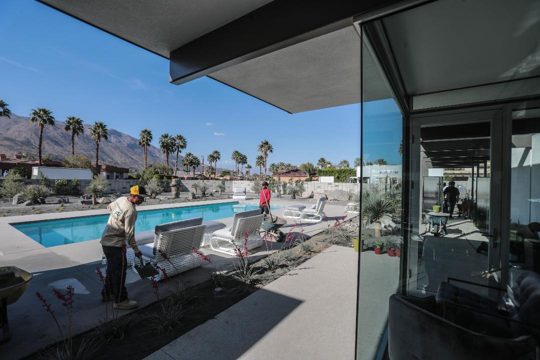 Workers on Thursday prepare Steel and Glass House 2018 for Modernism Week. The home is the last Palm Springs house designed by fame modernist architect Donald Wexler.