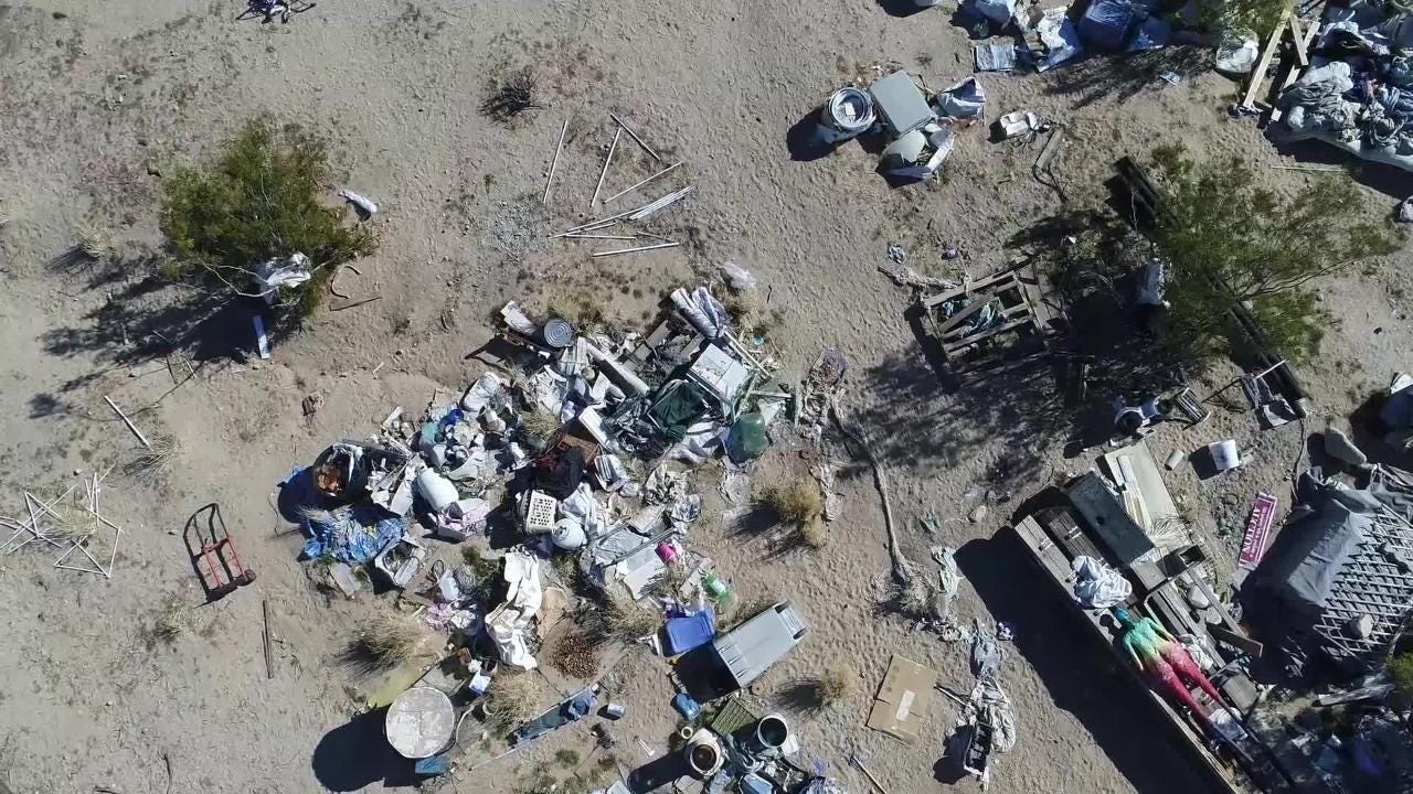 Sheriff's officials in San Bernardino County say a Joshua Tree homeless couple was raising their three malnourished children in a foul room-sized shack for the past four years.