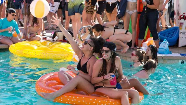 Thousands of LGBTQ women attend the Wet &wild Pool Party at the Palm Springs Hilton during the Dinah Shore Weekend. (April 1, 2017)