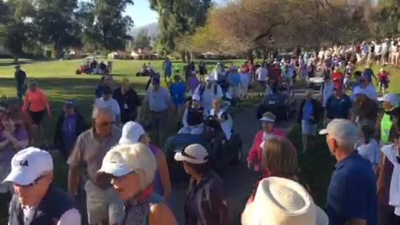 Fans scramble from one hole to the next during the ANA Inspiration playoff on Monday.