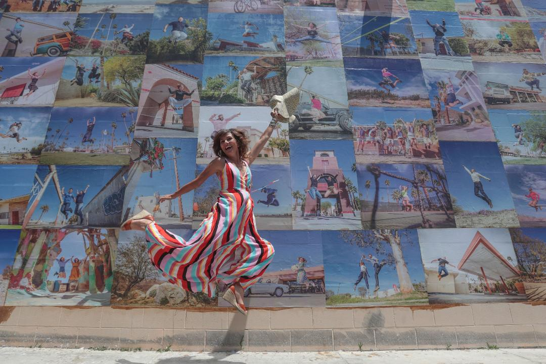 Artist Eyoalha Baker unveiled her mural made up of photos of Coachella Valley residents jumping on Saturday at the Palm Springs Cultural Center, formerly the Camelot in Palm Springs.