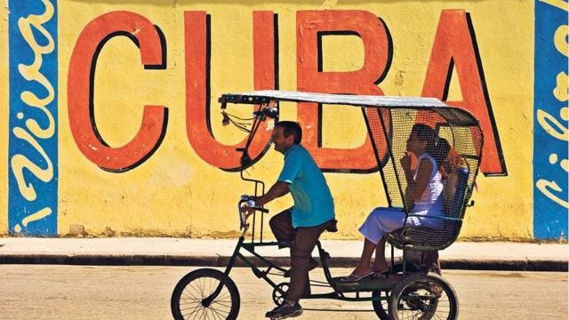 """President Donald Trump slammed former President Barack Obama's dealings with the communist regime in Cuba on Friday in Miami, charting his own course of more confrontational relations with the Castro-led government. The speech, which came as the President signed a directive outlining his posture toward Cuba, is the latest attempt by the Trump administration to chip away at Obama's legacy. Obama spent the last two years of his presidency looking to warm relations with Cuba, including a trip to the island in 2016. Casting the Obama administration as people who looked the other way on the Castro regime's human rights violations, Trump said that he, as President, will """"expose the crimes of the Castro regime."""" Trump listed some of the Castro regime's anti-United States actions, ranging back to the Cuban Missile Crisis, and added, """"We will never, ever be blind to it. We know what is going on and we remember what happened."""" Although Trump said he was """"completely"""" canceling Obama's Cuba policy, the change is posture is only a partial shift from Obama's policy. Diplomatic relations between the United States and Cuba will remain open, as will the newly opened embassies in Washington and Havana. And there will be no further restrictions on the types of goods that Americans can take out of Cuba, including the country's popular rum and cigars. Trump said he is keeping the embassy open """"in the hope that our countries can forge a much stronger and better path."""" The changes do, however, tighten restrictions on Cuba and ratchet up rhetoric on the Castro regime in hopes that it will lead to a transition of power on the island. Many presidents, though, have predicted the end of the Castros and, to date, none have been correct. The Trump administration will begin strictly enforcing the authorized exemptions that allow travel between the US and Cuba and prohibit commerce with Cuban businesses owned by the military and intelligence services. The President also directed Secretary of State"""
