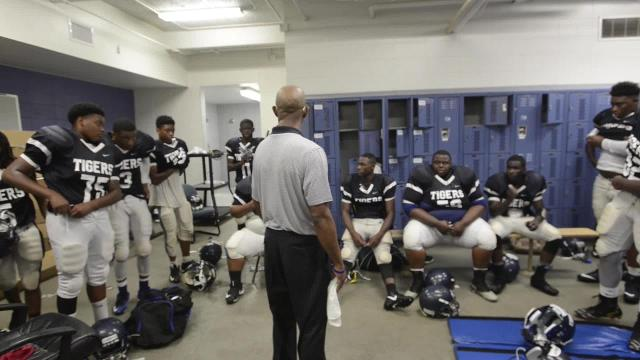 Coach Ervin Starr speaks to Calhoun High before game against Central