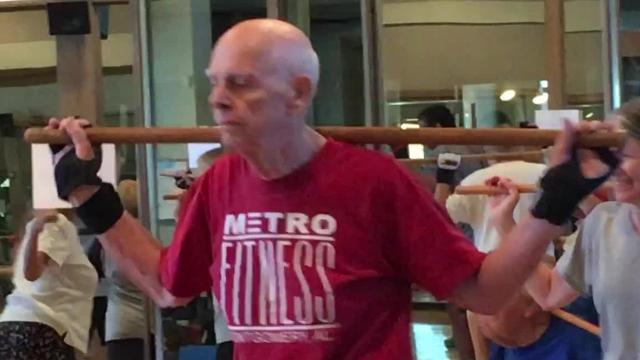 """At MetroFitness in Montgomery, """"athletes"""" with Parkinson's disease are balancing, stretching, boxing and tossing weighted-balls during 75-minute classes designed to help improve aerobic fitness and muscle strength."""