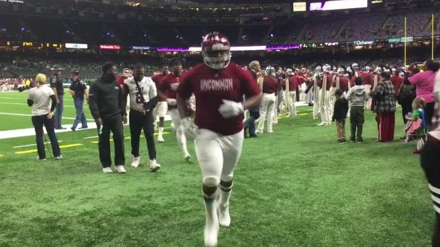 The Troy Trojans leave the field following warmups before facing North Texas in Saturday's New Orleans Bowl.