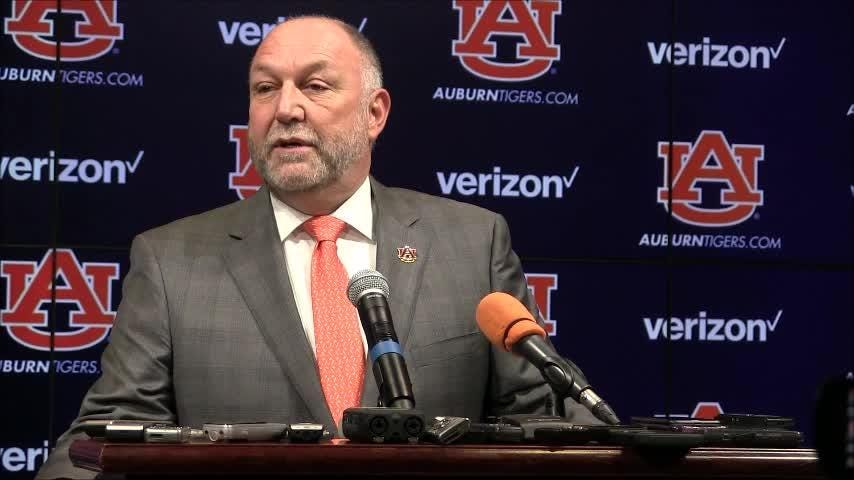 Auburn president Steven Leath and board of trustees member Quentin Riggins discuss the hiring of new athletic director Allen Greene.