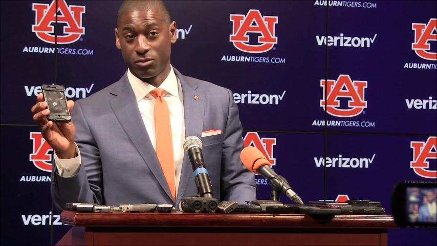 After having fun with a iPhone, new Auburn athletic director Allen Greene turned serious in discussing how he's handled issues while at Buffalo.