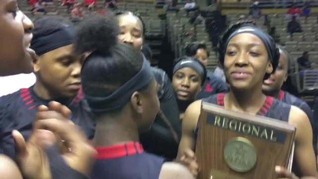 The Robert E. Lee girls basketball team celebrates winning the Class 7A Central Regional championship Tuesday at the Acadome.