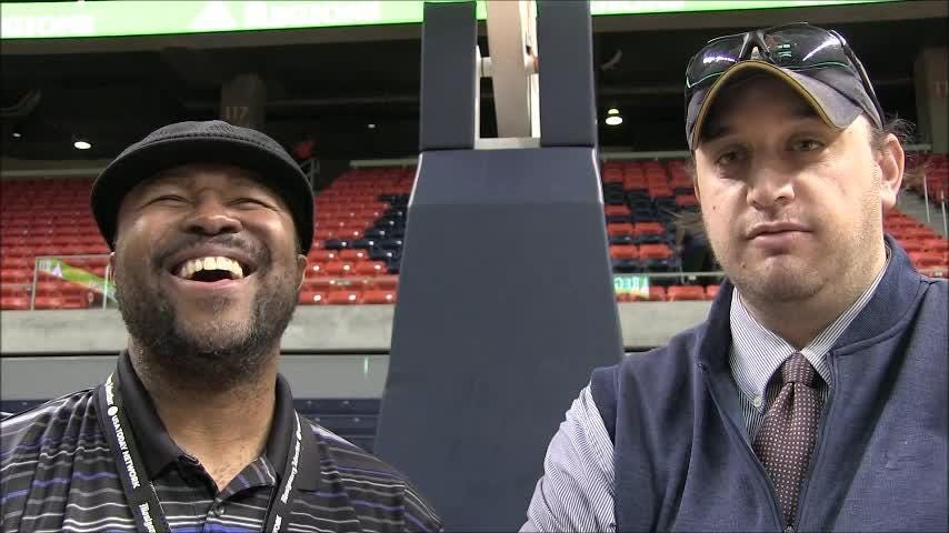 Montgomery Advertiser columnist Duane Rankin and Auburn beat writer Matthew Stevens have fun discussing the  Iron Bowl trophy being presented at halftime of the men's basketball game between Auburn and Alabama the Tigers won, 90-71, at Auburn Arena.