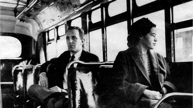 "When 42-year-old secretary Rosa Parks was arrested for refusing to surrender her seat on a Montgomery, Alabama, bus to a white passenger on December 1, 1955, she quickly became dubbed ""the first lady of Civil Rights,"" helping spark a movement that would last throughout the Sixties. Her act of defiance against racist Jim Crow laws has been cemented as one of the most significant symbols of the civil rights movement in U.S. In a series of pictures, the world remembers her courageous act for racial equality with a series of pictures that capture of her life's work for justice and equal rights. From her now-iconic booking photo taken at the time of her arrest to Bill Clinton presenting Parks with the 1996 Presidential Medal of Freedom, these photos are a testament to the ongoing fight for equality that continues today."