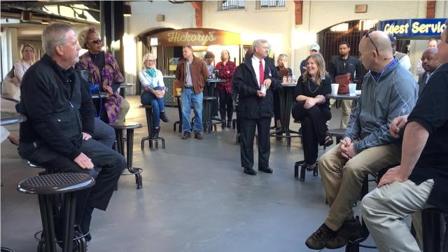 The city said it banned open containers in its downtown entertainment district this year after complaints from residents and business owners. Montgomery Mayor Todd Strange listened to feedback during a March 13 meeting of the Downtown Business Association.