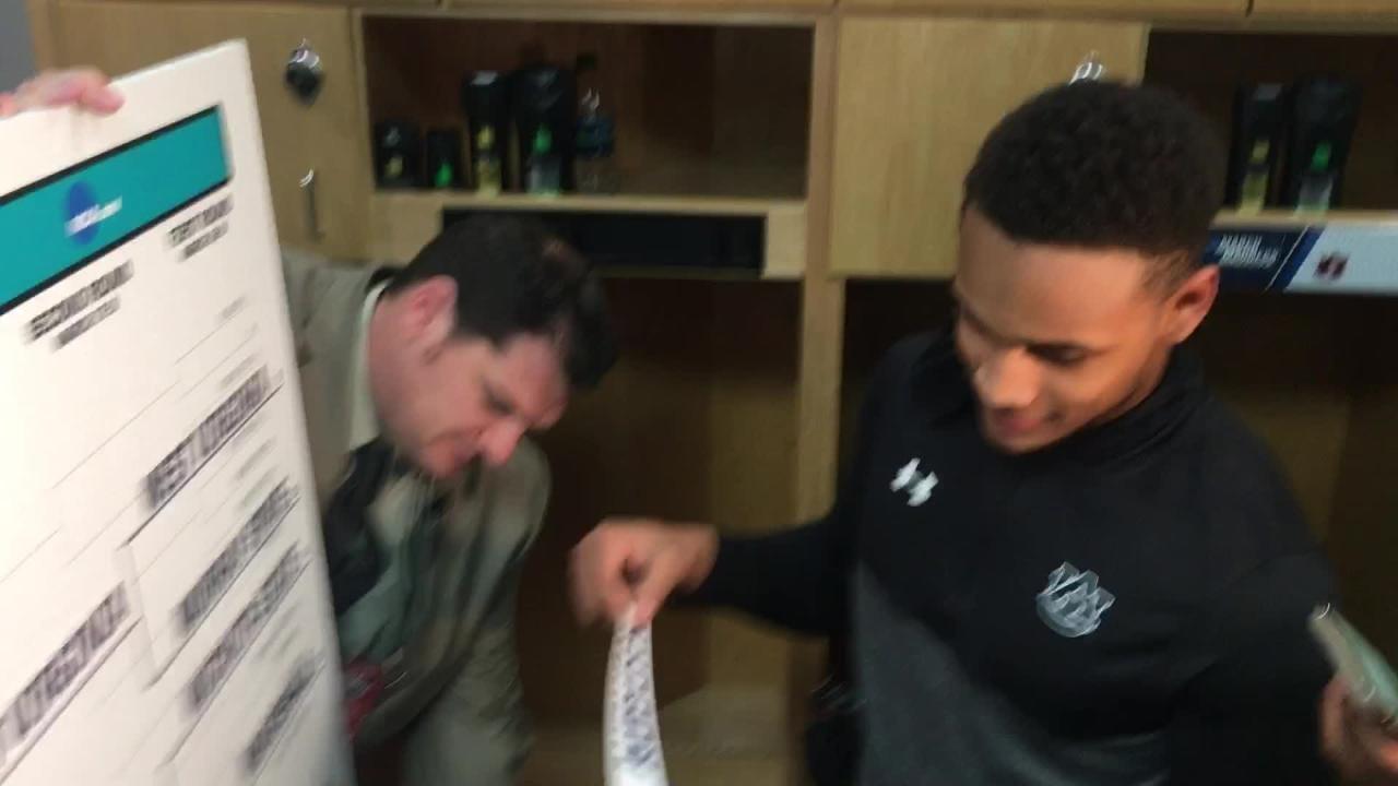 Auburn guard Bryce Brown puts the 'Auburn' sticker on the NCAA Tournament bracket.