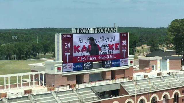 VIDEO: Troy Trojans: Al Pogue's scoreboard karaoke needs work