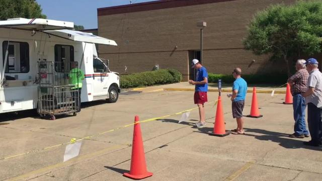 Customers at the Prattville Post Office have been lining up in the parking lot since an April 16 fire damaged the building.
