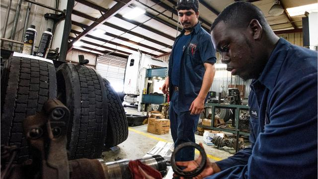 Nicholas Smith and Timothy Bibb recently finished the apprenticeship program at Four Star Freightliner in Montgomery and now work on big rigs.
