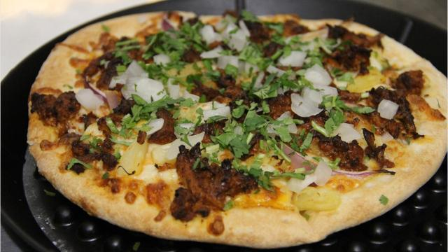 Fiesta Pizza on Lancaster serves pizzas with taco-style fillings, like chorizo, adobo-marinated meat and beans.