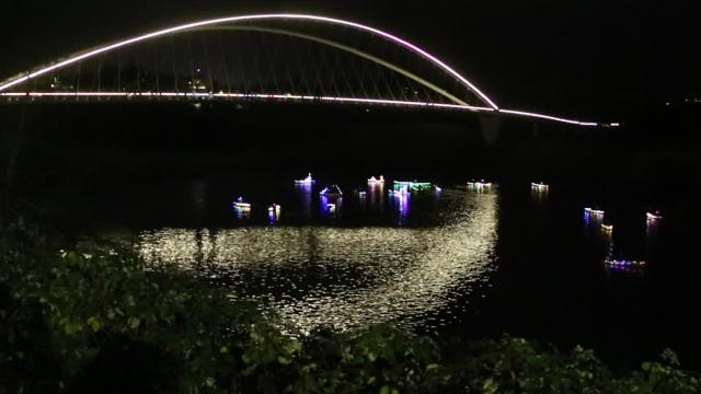 Kayaks and canoes decorated in twinkling lights floated along the Willamette River by Riverfront Park for the 13th annual Illuminata Regatta on Saturday, Dec. 16, 2017.