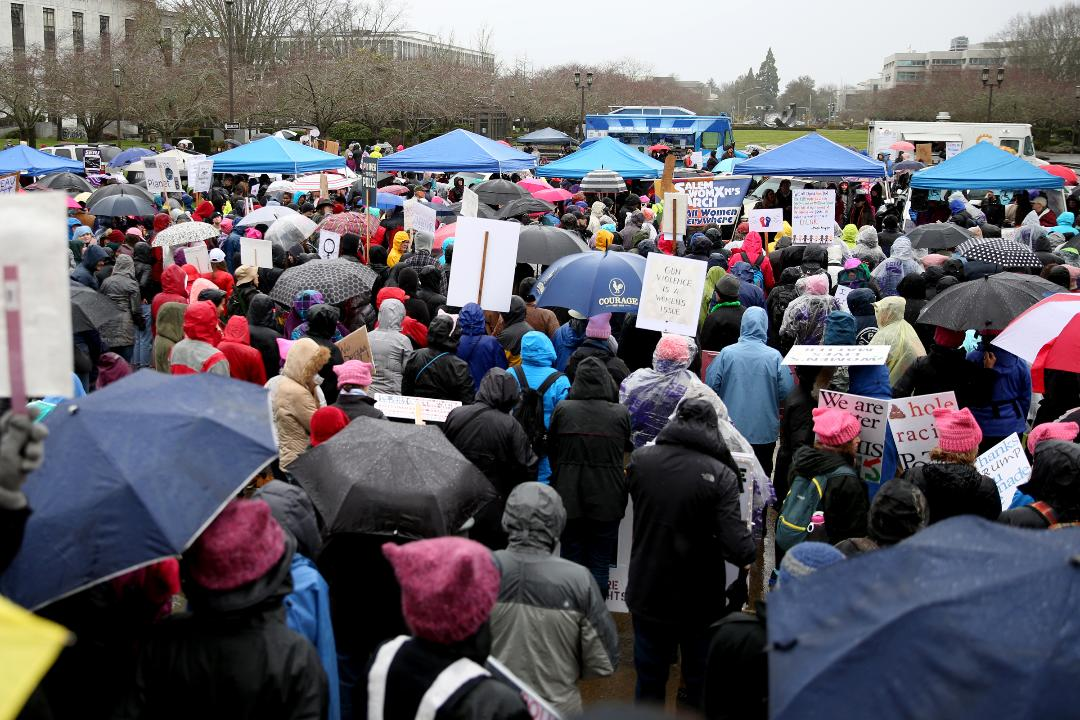 About 1,000 people march in Salem as part of a weekend of equal rights demonstrations around the world.
