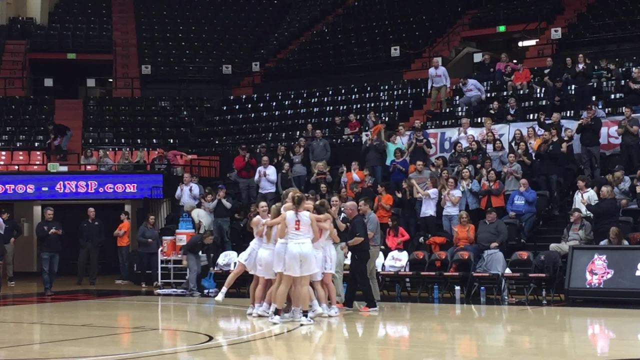 Silverton players celebrate a 47-29 win over Bend in the third-place game in the OSAA 5A state tournament at Gill Coliseum on March 9, 2018.