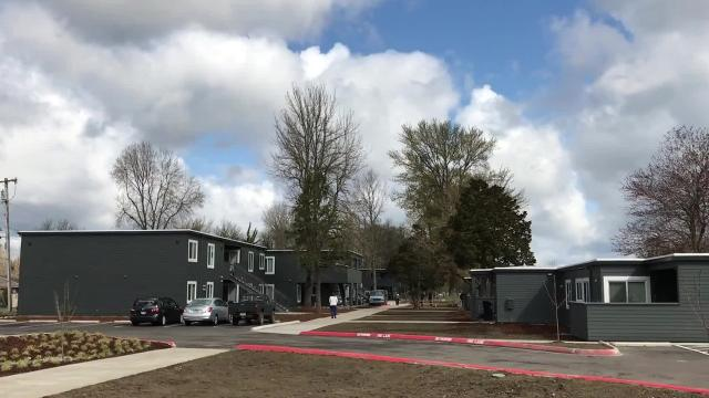 A Salem housing complex reopened Monday, preserving affordable options for low-income residents and helping some in a city homeless relief program.