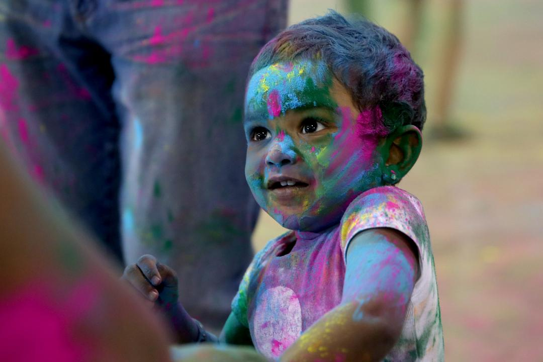 The Indian festival celebrates the start of spring with the throwing of colored powders.