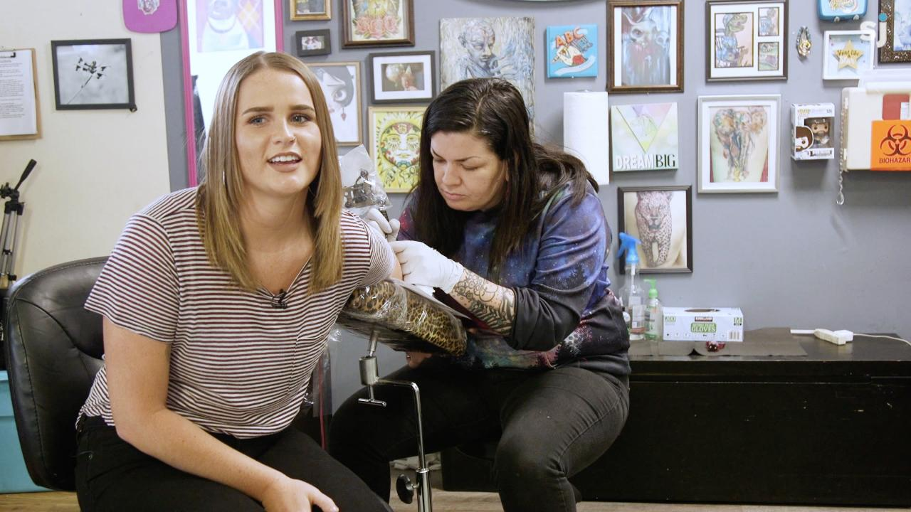 Abby Luschei, the Statesman Journal entertainment reporter, gets a tiny tattoo with a personal significance during Tiny Tattoo Tuesday, a monthly special at Oregon Body Art center in Salem.