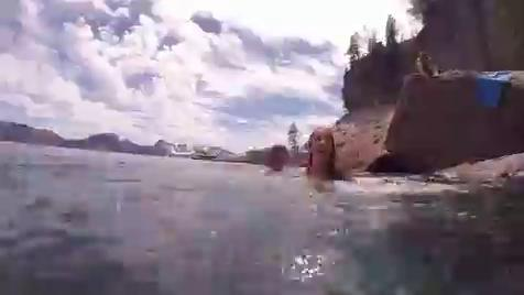 Stefan O'Neill, Emilie Hartvig, Alisha Roemeling and Tyler Dodds take a short swim in Crater Lake and take some underwater footage with a GoPro.