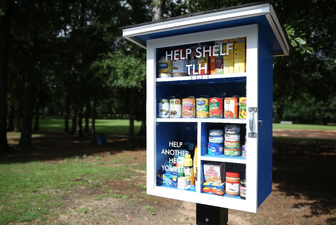Leadership Tallahassee members launched four free, outdoor pantry boxes across town Monday.