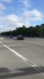 Massive motorcade of FHP troopers just cruised in front of center. Positioning for Spencer's speech.