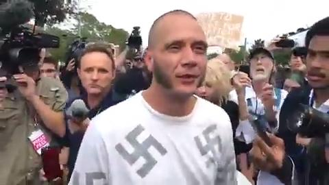 Watch it: Man with swastika shirt escorted out of the scene
