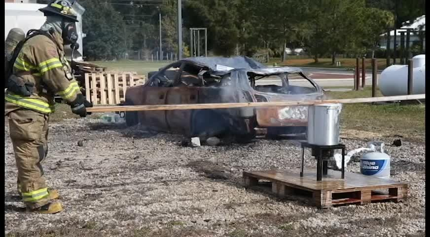 Tallahassee Fire Department Division Chief Michael Hadden and Engineer Sarah Cooksey explain why you never want to put a frozen turkey into a fryer with a demonstration at the TFD Training Facility Nov 20.