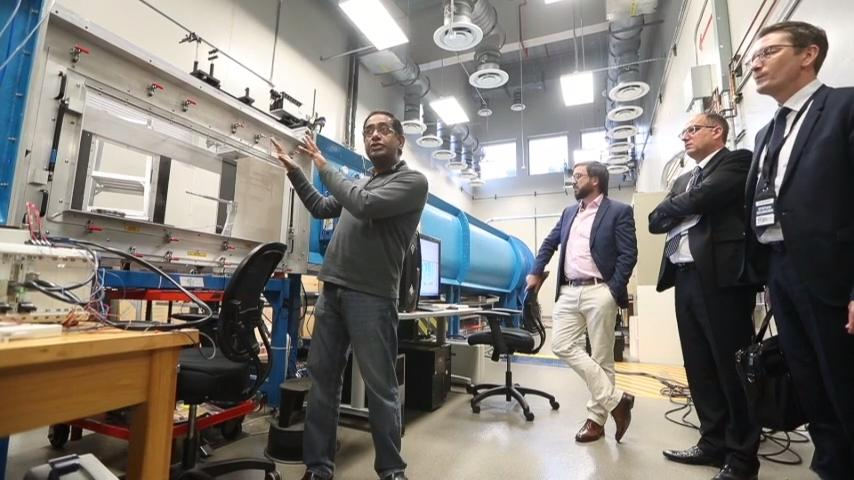 Associate Professor of Mechanical Engineering Rajan Kumar speaks to an international group at the at the  Aero-Propulsion, Mechatronics and Energy Building in Innovation Park