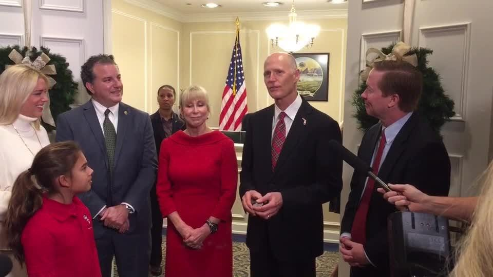 A Tallahassee tree farmer presents Governor with a Florida grown Christmas tree