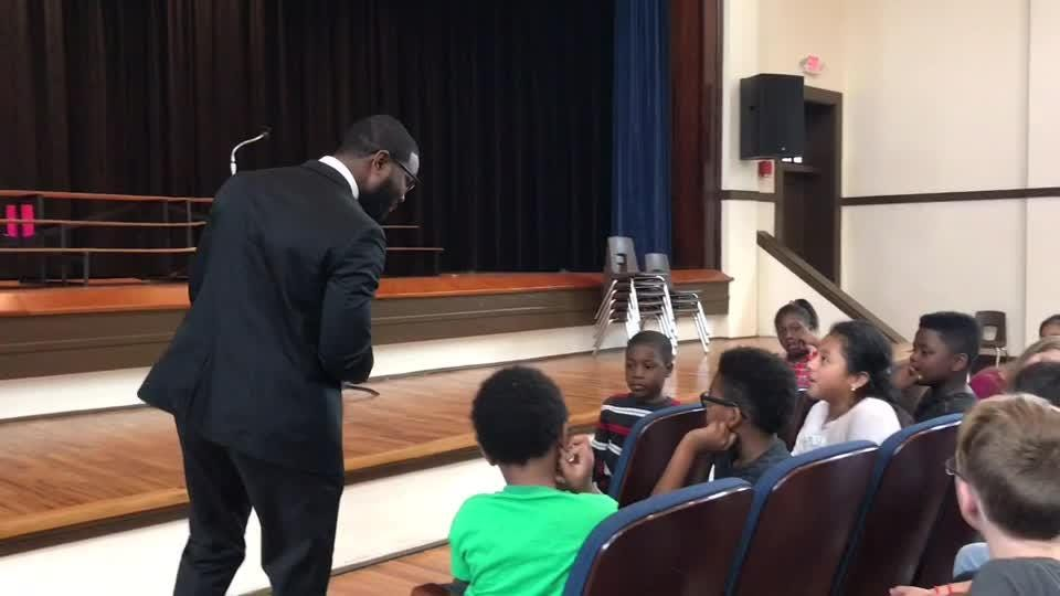Cairo Mayor Elect Booker Gainor, a Florida A&M University alum, talks with students at Aouthside Elementary School in Cairo, Georgia.