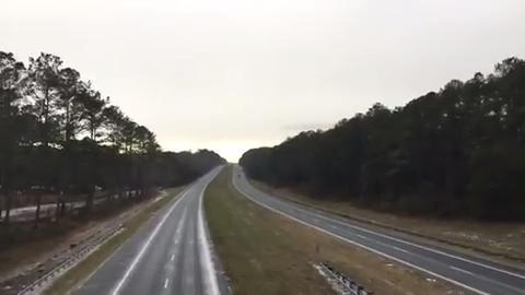 Watch it: Snow in Centerville Road over I-10