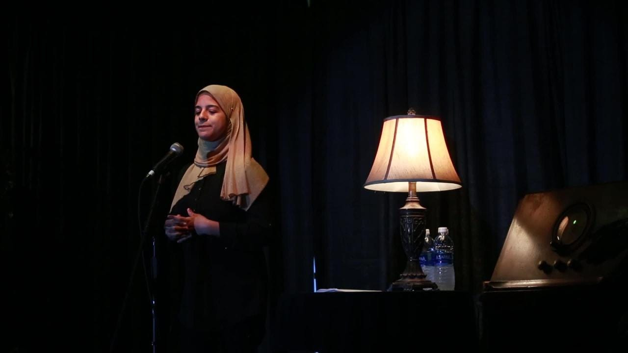 Nada Hassanein tells a story about Barbie and identity onstage at the Junction at Monroe during the Tallahassee Democrat's first Storytellers Project event Jan 29, 2018.