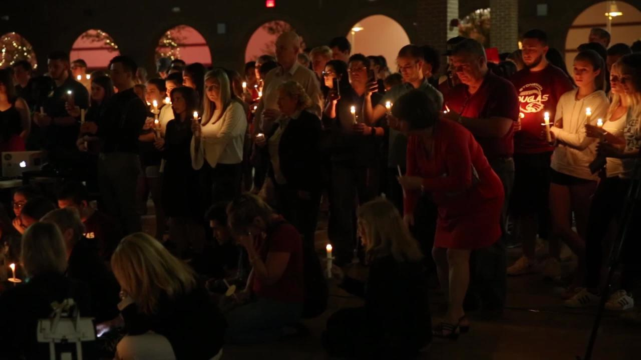 The names of the 17 people who lost their lives in the shooting at Stoneman Douglas High School on Feb. 14, 2018, are read during a candlelight vigil held for the victims at the Centre of Tallahassee Monday, Feb. 19, 2018.