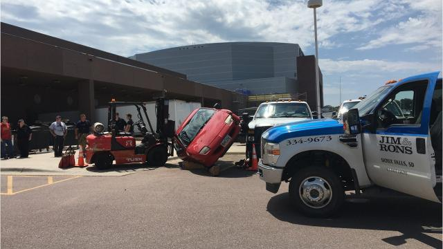 An impaired driver jumped into a trash compactor trying to run from police and assaulted an officer after parking her car on a truck July 21.
