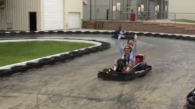 While Garth Brooks was gearing up for a football camp, Trisha Yearwood killed time Saturday morning in Sioux Falls by riding a go-kart at Thunder Road.