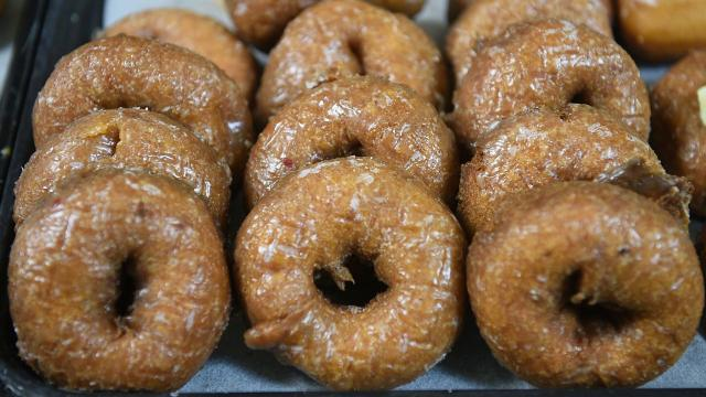 Flyboy Donuts owner Ben Duenwald talks about his restaurant's new pumpkin donut. By Sam Caravana / Argus Leader