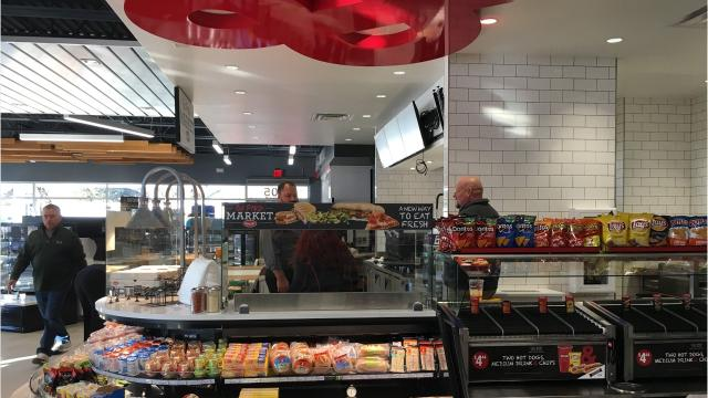 Kum & Go's newest gas station in Sioux Falls, its largest in the city, features a 'food first' design with food made in-store, an expansive beer cave, indoor and outdoor seating and free wi-fi and charging ports.