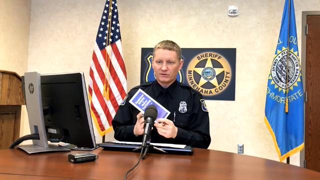 Police spokesman Sam Clemens goes over the call log on Jan. 11, 2018.
