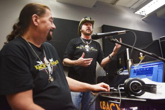 "Crash, ""Crazy"" Frank Anderson, Jeff ""The Rev"" Koller and ""Metal Cowboy"" Ron Keel host KBACK radio Monday, Jan. 29, at their new studio in downtown Sioux Falls."