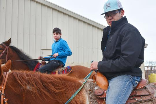 Omi Schulte, 20, and TJ, 16, talk about how they found out they were brothers at McCrossan Boys Ranch with TJ's favorite horse, Larz, Friday, Jan. 19, at the ranch. Omi and TJ found out they were brothers in August of 2017.
